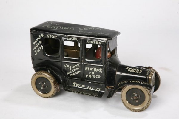"""1012: LEAPING LENA"""" CAR BY STRAUSS. Wind up tin car by"""