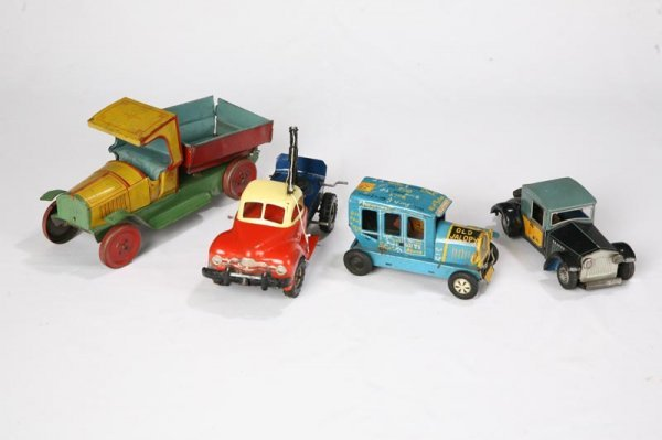 1016: FOUR TIN TOY CARS AND TRUCKS. Japanese friction a
