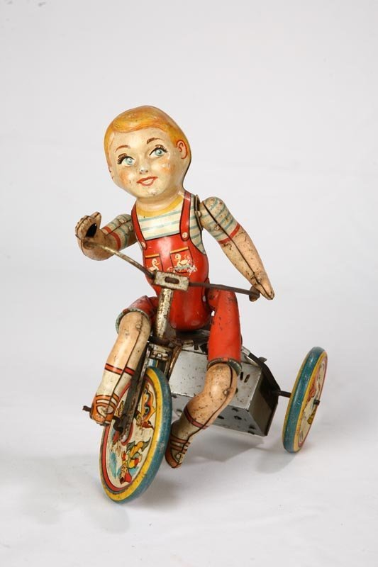 """1018: TIN WINDUP KIDDY CYCLIST"""". Lithographed toy by Un"""