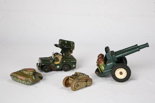1020: FOUR TIN ARMY TOYS. Two tanks, Japanese friction,