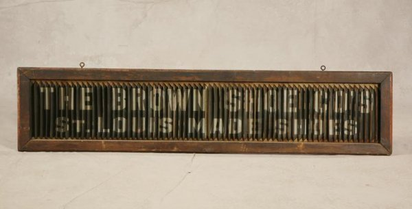 1408: WOOD AND METAL LOUVERED ADVERTISING SIGN. In one