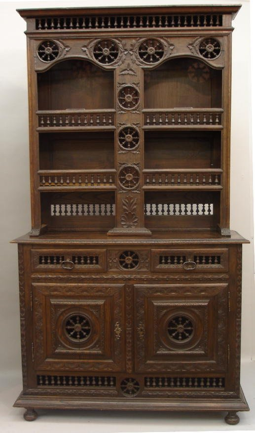 2: EUROPEAN CARVED TWO-PART CUPBOARD. Oak with an old d