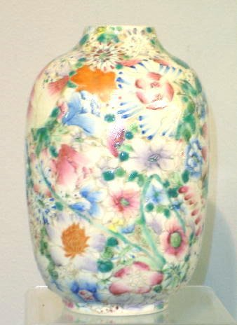 13: SMALL ORIENTAL VASE. Overall floral design with inc