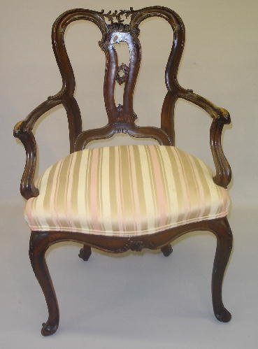 14: LOUIS XV STYLE ARMCHAIR WITH ROCOCO CARVING. Walnut