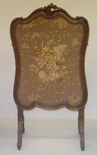 15: CARVED FRENCH STYLE FIRESCREEN. Walnut with an old