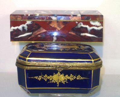 23: TWO BOXES. Porcelain with a painted blue Sevres mar