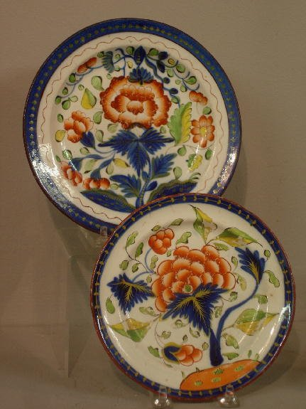 426: TWO GAUDY DUTCH PLATES. The larger is carnation (s