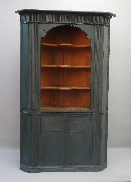 439: TWO-PIECE OPEN CORNER CUPBOARD. Attributed to the