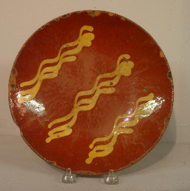 444: REDWARE PIE PLATE. Coggled rim and wavy line decor