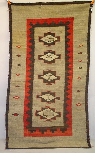 828: LARGE EARLY NAVAJO RUG. A finely carded gray backg