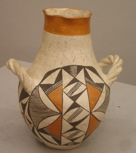 832: ACOMA POTTERY JAR WITH TWIST HANDLES. Older polych