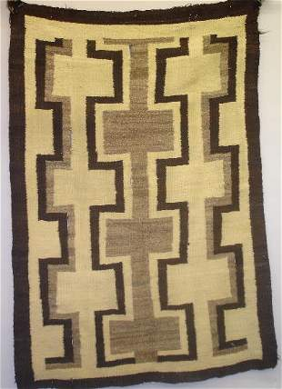 TRANSITIONAL PERIOD NAVAJO RUG. Lovely hand cardin