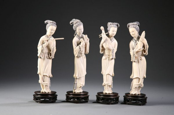 411: FOUR CARVED IVORY WOMEN.