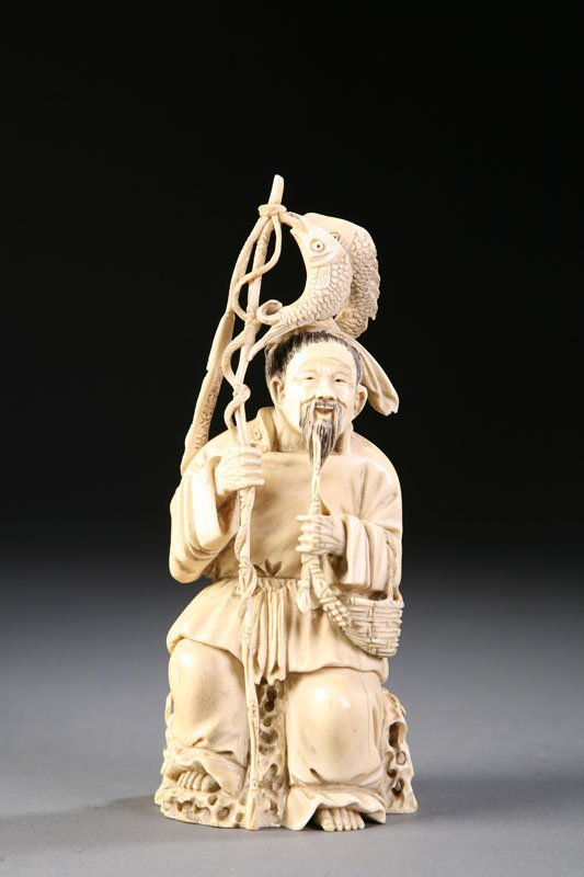 413: ORIENTAL IVORY CARVING OF FISHERMAN.