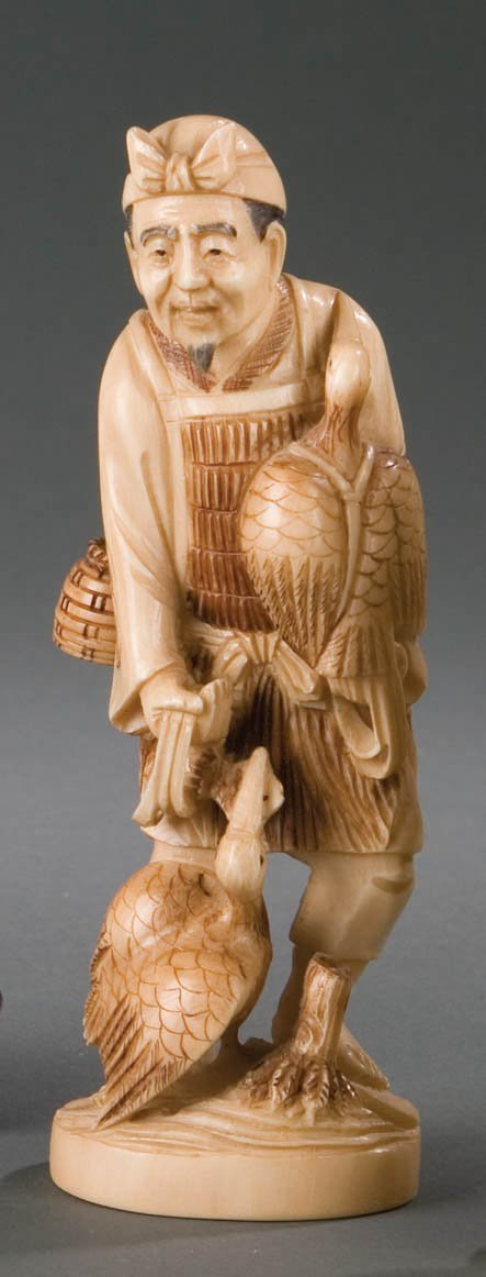 415: IVORY FIGURE OF FISHERMAN.