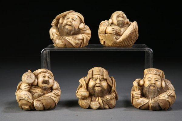 417: FIVE JAPANESE IVORY CARVINGS.