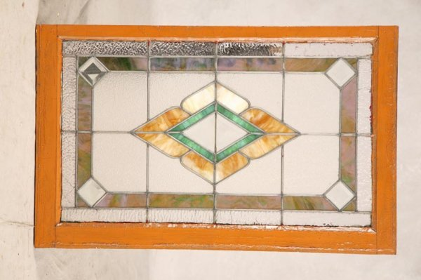 1001: STAINED GLASS WINDOW. Leaded glass panel sash. Ge