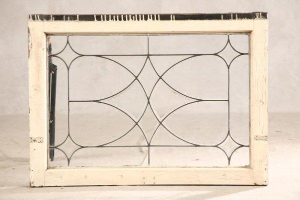1002: LEAD GLASS WINDOW. White wood frame and geometric