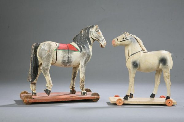 1008: TWO HORSE PULL TOYS. Painted wooden horse with re