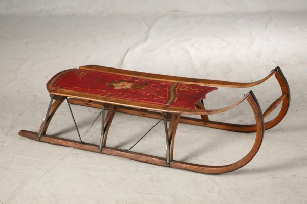 1009: CHILDS SLED. The seat has red paint with a yellow