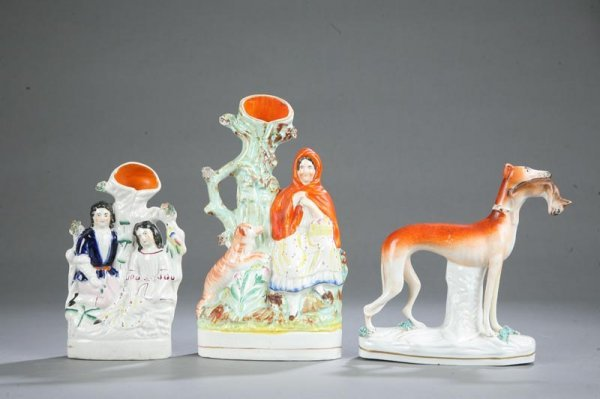 1020: THREE PIECES OF STAFFORDSHIRE. Two chimney vases,