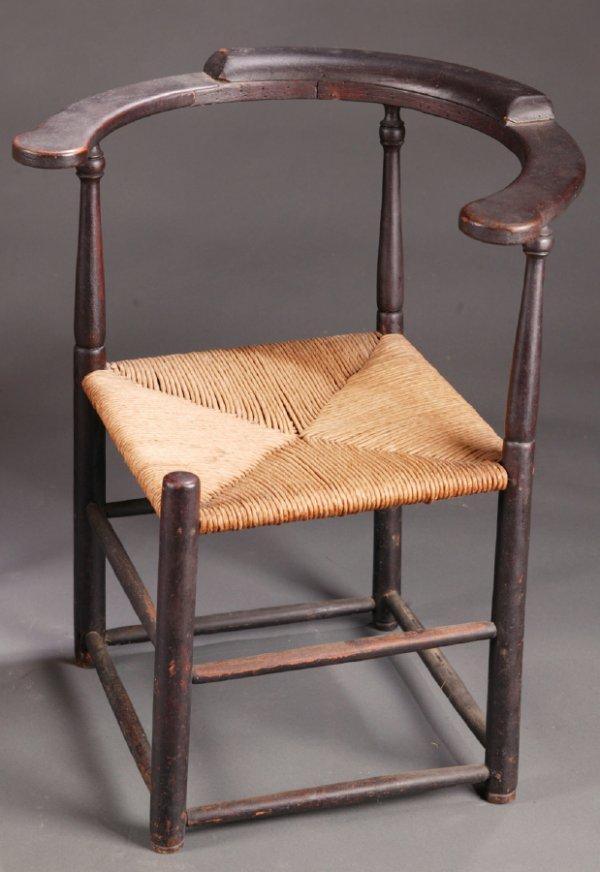 2428:  CORNER ARMCHAIR.    American, Ca.1800, mixed woo