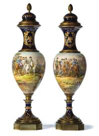 A PAIR OF SEVRES NAPOLEONIC DECORATED URNS, ARTIST