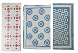 THREE AMERICAN PIECED QUILTS.