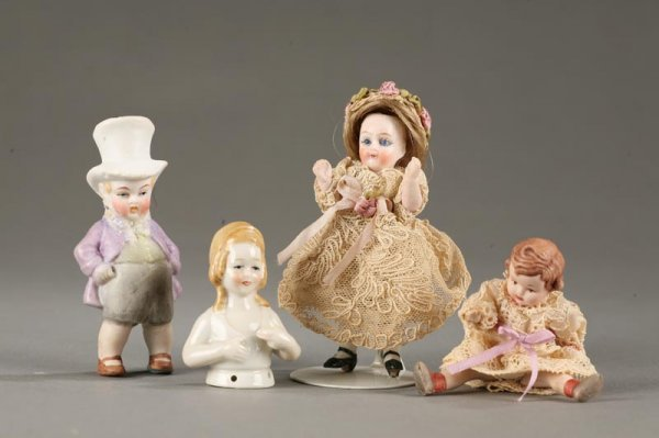 23: FOUR SMALL DOLLS.