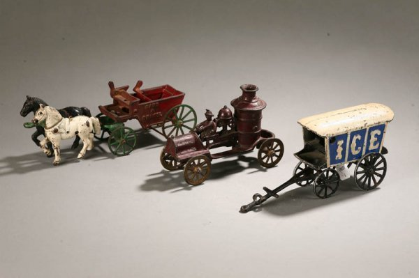 1003: THREE CAST IRON TOYS. Ice truck with white and bl