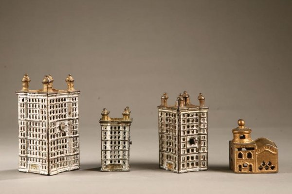 1009: FOUR CAST IRON BUILDING BANKS. A.C. Williams skys