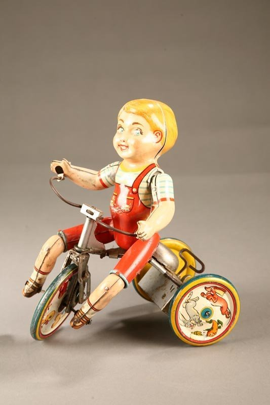 "1019: TIN WIND UP TOY. Kiddie Cyclist"" by Unique Toys."