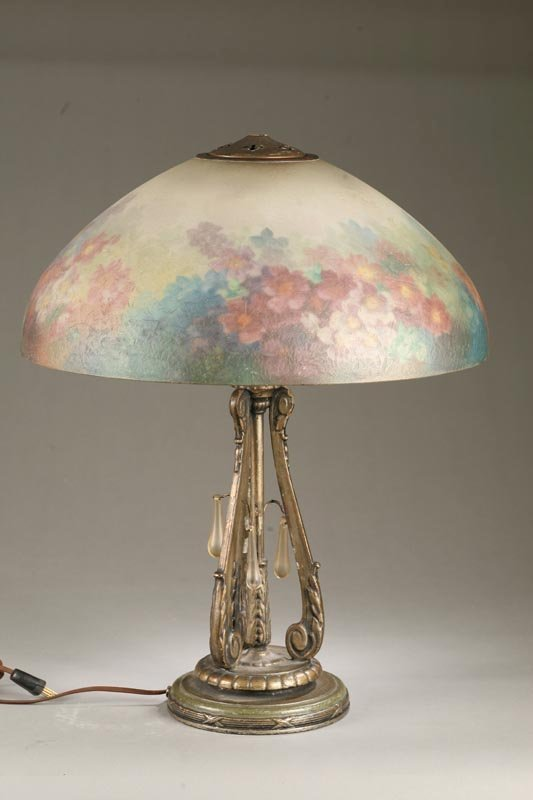 1055: HANDEL LAMP. Reverse painted table lamp with mult