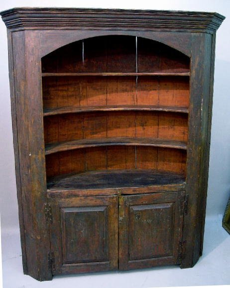 676: EARLY ONE-PIECE BARREL BACK CUPBOARD. At