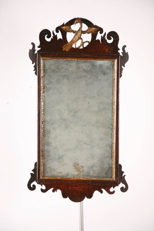 21: CHIPPENDALE MIRROR WITH PHOENIX CREST.