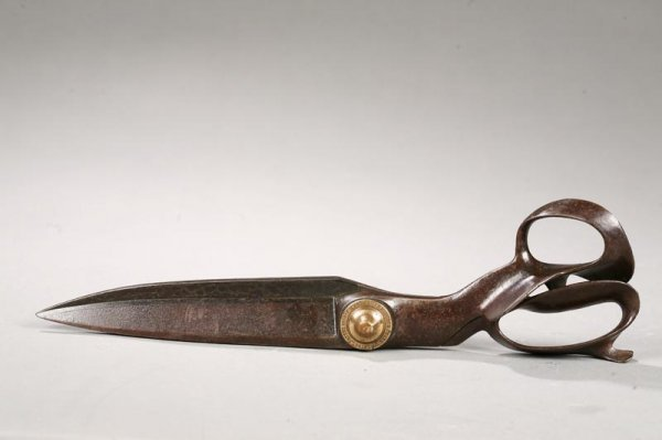 1002: CAST IRON TAILORS SHEARS. With brass button, sign