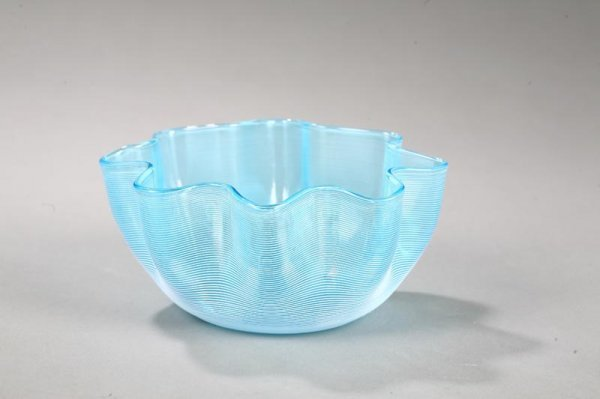 1015: ART GLASS THREADED BOWL. Light blue with white th