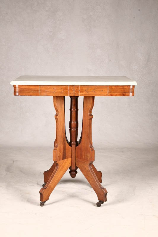 1023: VICTORIAN PARLOR STAND. Walnut with Eastlake base