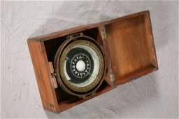 1114: BRASS SHIPS COMPASS IN WOODEN BOX. Large compass
