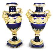 PAIR OF COBALT URNS WITH GILDED BRONZE MOUNTS.