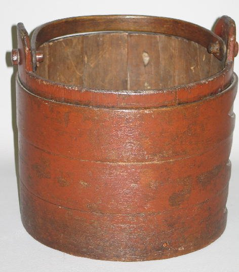 436: STAVE CONSTRUCTED BUCKET IN OLD RED PAINT. Three b