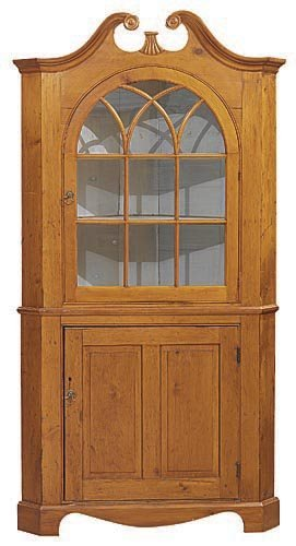 638: COUNTRY TWO PIECE CORNER CUPBOARD. Pine with a gol