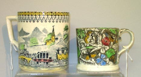 18: TWO TRANSFERWARE MUGS. Both are handcolored. Larger
