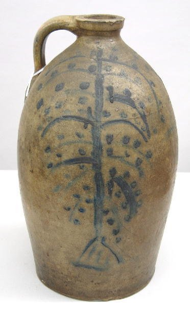 374: STONEWARE JUG. To one side is an unusual tree desi