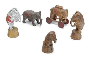 FIVE CIRCUS ELEPHANT-THEMED STILL BANKS.