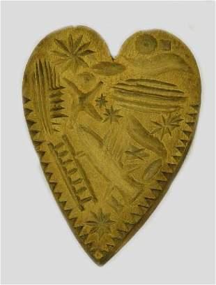 16: BUTTERPRINT. Heart shaped with a pine tre