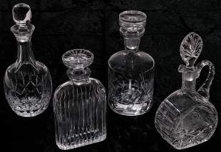 FOUR AMERICAN GLASS DECANTERS.