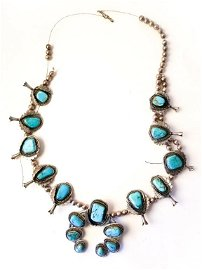 SILVER AND TURQUOISE SQUASH BLOSSOM NECKLACE.