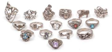 SIXTEEN VINTAGE STYLE STERLING SILVER RINGS.