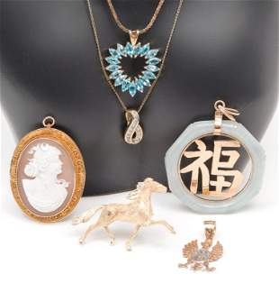 SIX PIECES MOSTLY GOLD JEWELRY.